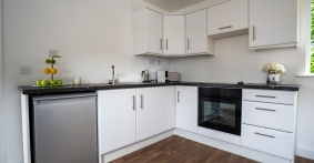 skyclad homes kitchen with fridge, cooker and sink photography production