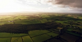 drone aerial photography production of farming field in rural Ireland