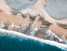 drone aerial photography production of crashing waves on beach in Dublin