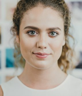 headshot of a woman in an office during a photography production shoot