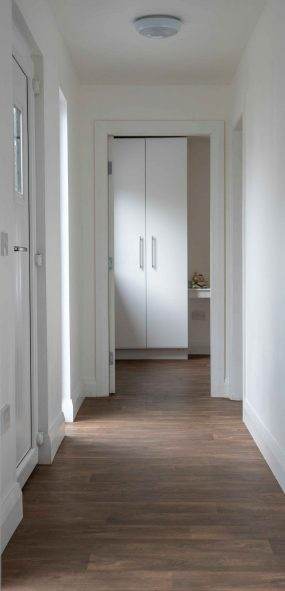 skyclad homes hallway with multiple doors photography production